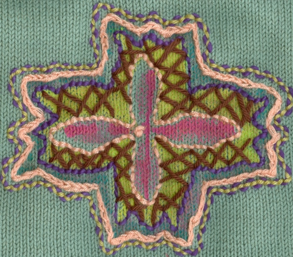 """stencil and embroidery on knitting"""