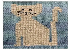 """""""Cross stitch cat on knitted background"""""""
