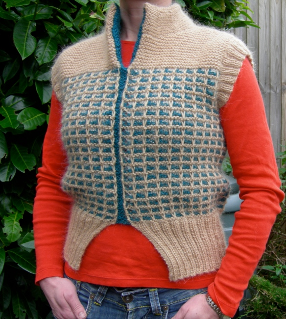 """knitted sleeveless pullover"""