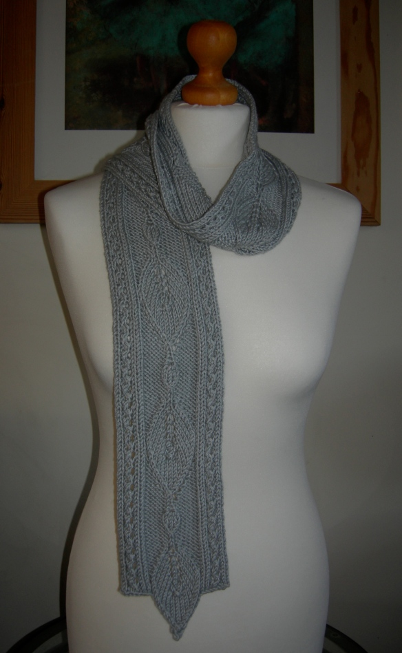 """hand knitted textured scarf with lace edging and leaf motif"""