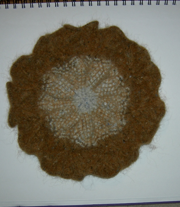 """Knitted circular lace after felting"""