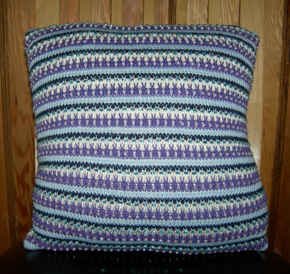 """Nicky Barfoot hand knitted cushion"""