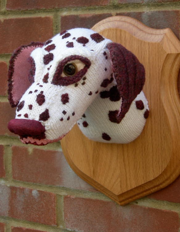 """Knitted Dalmatian dog head sculpture"""