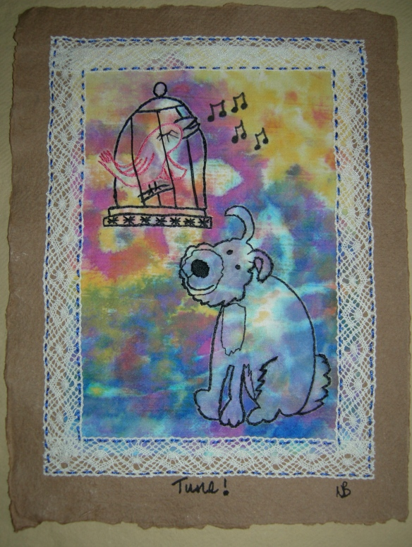 """hand embroidered doggy doodle on painted calico"""