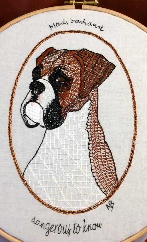 """hand stitched doggy doodle on calico"""